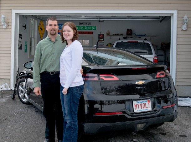 Steven and Amanda Judd in front of their Chevy Volt